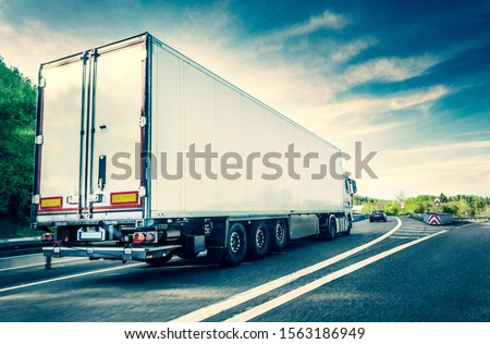 White truck on german highway with slight motion blur #1563186949