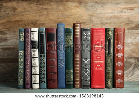 Collection of old books on wooden shelf #1563198145