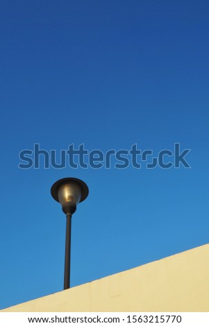 Illumination in outdoor parks with blue background.Modern street lamp against the blue sky without clouds #1563215770