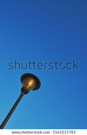 Illumination in outdoor parks with blue background.Modern street lamp against the blue sky without clouds #1563215782