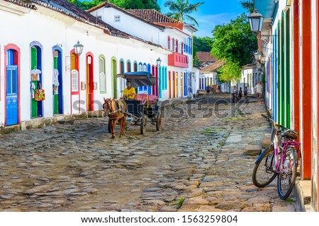 Street of historical center in Paraty, Rio de Janeiro, Brazil. Paraty is a preserved Portuguese colonial and Brazilian Imperial municipality. Cityscape of Paraty Royalty-Free Stock Photo #1563259804
