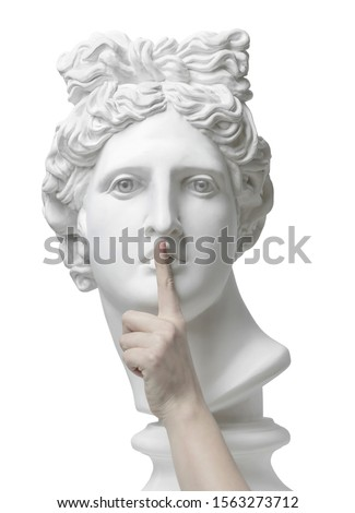 Sign of silence. Gypsum statue of Apollo's head with finger on lips. Eyes wide open. Statue. Silence. sssh. Verbosity. Quiet. Знак тишины. Coronavirus. Connection. Keep silence. The secret concept #1563273712