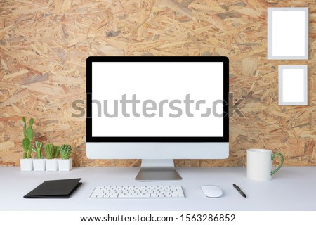 Computer with blank white copy space for text, Mockup design desktop computer in office on white table with keyboard and Coffee cub, Work place concept, Cactus in pot. #1563286852
