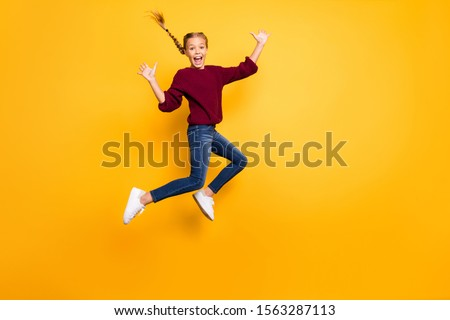 Full length body size view of her she nice attractive lovely crazy overjoyed glad girlish cheerful pre-teen girl jumping having fun isolated on bright vivid shine vibrant yellow color background #1563287113