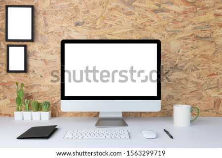Computer with blank white copy space for text, Mockup design desktop computer in office on white table with keyboard and Coffee cub, Work place concept, Cactus in pot. #1563299719