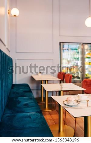 Interior image of cozy and stylish tea room, bakery #1563348196