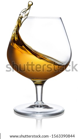 splash of cognac in a snifter isolated on white background #1563390844
