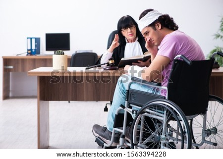 Disabled man consulting judge for damages litigation #1563394228