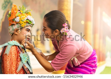 concept of Traditions Lanna novice monk tradition after having broken the head, must wear traditional style, draw eyebrows, red eyes, put on bracelets, necklace, Sangkhathan and pray for adult parade. #1563402946