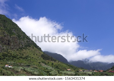 Panoramic view of the mountains surrounded by clouds in the coutryside of Sao Vicente (Madeira, Portugal, Europe) #1563431374