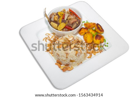 A plate of home chef Beef Kata Masala, plane flavourful nutty pulao and little poteto fried. Top view. on white background. #1563434914