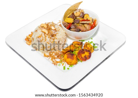 A plate of home chef Beef Kata Masala, plane flavourful nutty pulao and little poteto fried. Top view. on white background. #1563434920