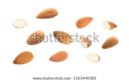 Tasty almonds on white background #1563440383