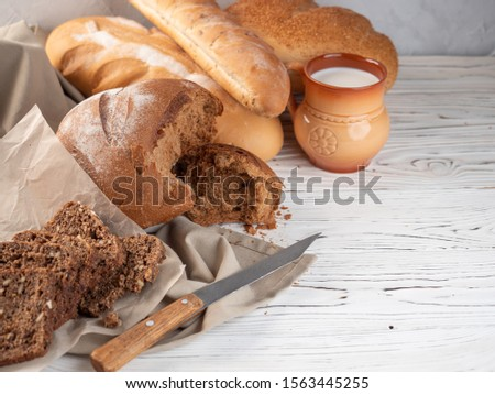 Different breads on a wooden table. #1563445255