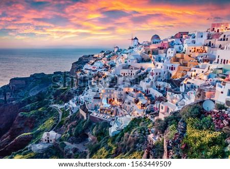 Astonishing evening view of Santorini island. Magnificent summer sunset on famous Greek resort Oia, Greece, Europe. Fantastic seascape of Mediterranena sea. Traveling concept background. #1563449509