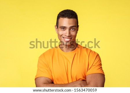 Confident and cheeky masculine man in t-shirt, cross arms chest self-assured pose, smiling as have no doubts can win, assertive and pleased standing yellow background, share interesting news #1563470059