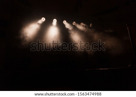 bright spotlights in the dark. stage lighting #1563474988