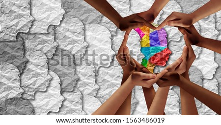World Autism awareness day as a mental health concept and Autistic social developmental education disorder symbol as a child special learning icon with the support of caregivers shaped as a heart. #1563486019