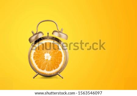 Layout fresh orange slice alarm. Fitness concept #1563546097