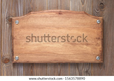 wooden sign board at wall background