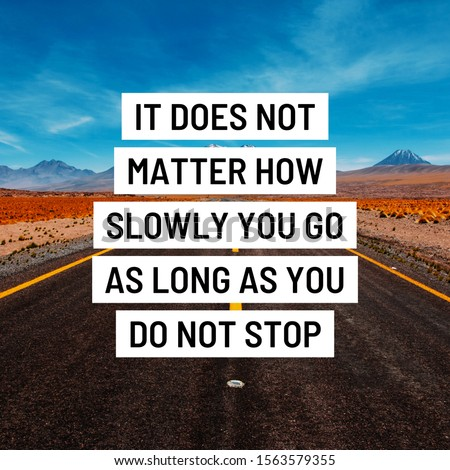 """Inspirational motivating quote"""" it doesn't matter how slowly you go as long as you do not stop"""" written on retro background. #1563579355"""