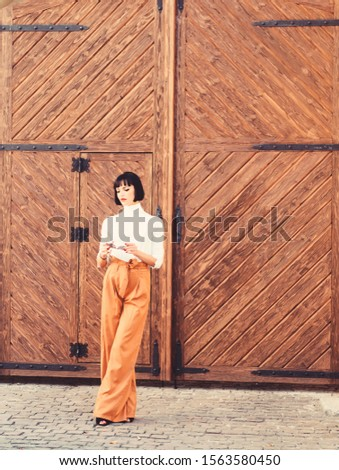 High waisted trousers. Woman attractive brunette wear fashionable clothes. Femininity and emphasize feminine figure. Girl makeup face wear loose high waisted pants. High waisted pants fashion trend. #1563580450