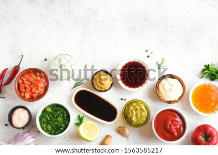 Sauces Assortment. Set of various sauces. Popular sauces in bowls, top view, copy space. Homemade sauces or dip. #1563585217