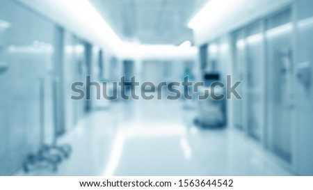 blur background of modern hospital ICU corridor interior, medical and healthcare concept Royalty-Free Stock Photo #1563644542