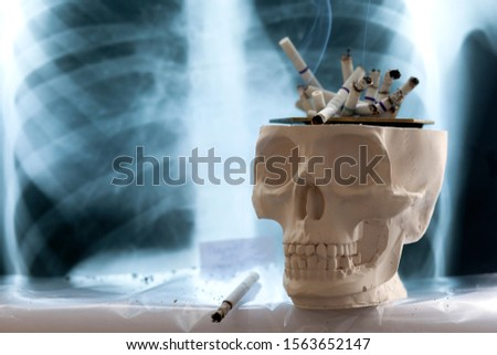 concept of the dangers of smoking cigarettes, the danger of cigarette smoke to humans, copy space #1563652147