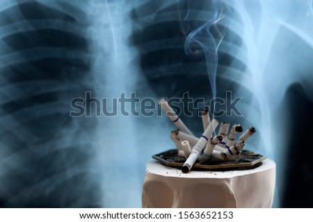 concept of the dangers of smoking cigarettes, the danger of cigarette smoke to humans, copy space #1563652153