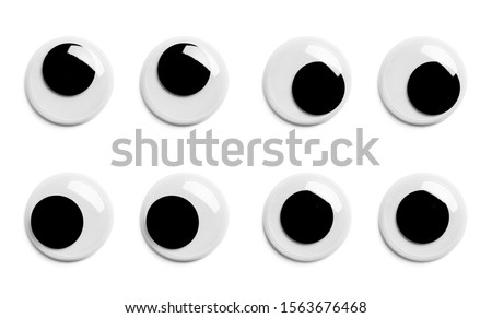 Various Pairs of Googly Eyes Isolated on White Background. Royalty-Free Stock Photo #1563676468
