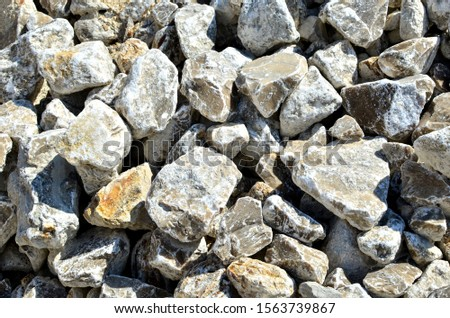 Natural gray gypsum stone. Close up image of stones with black and white. Industrial mining area. Limestone mining, quarry - Image #1563739867