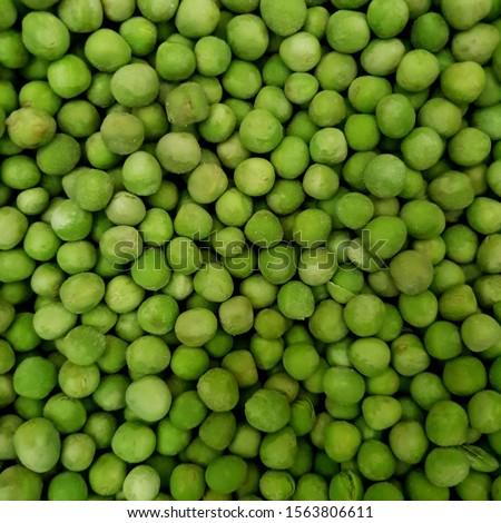 Macro photo green frozen peas. Stock photo food vegetable frozen peas #1563806611