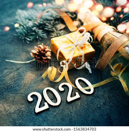 happy new year 2020 background with champagne in dark color with bokeh #1563834703