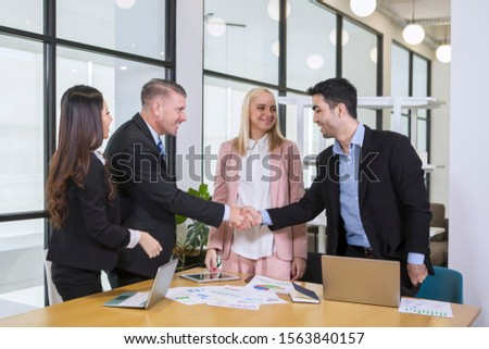 Two businessman shaking hands - Diversity team in business concept #1563840157