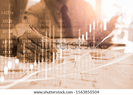 Stock market or forex trading graph and candlestick chart suitable for financial investment concept. Economy trends background for business idea and all art work design. Abstract finance background. #1563850504