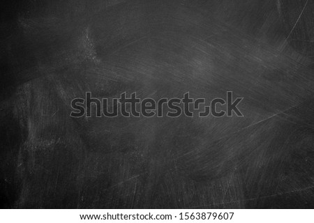 Abstract texture of chalk rubbed out on blackboard or chalkboard background, can be use as concept for school education, dark wall backdrop , design template , etc. Royalty-Free Stock Photo #1563879607
