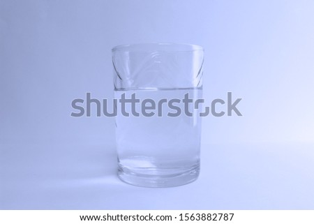 Glass of water blue liquid #1563882787