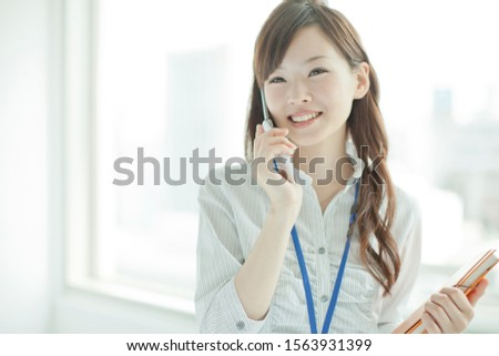 Business woman working in the company #1563931399