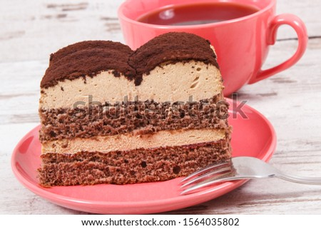Fresh creamy tiramisu cake with different layers and black coffee. Concept of delicious dessert for celebrations #1564035802