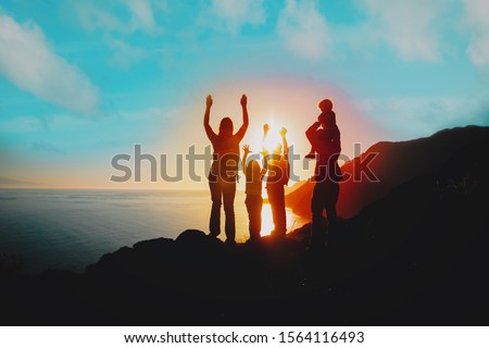 happy family with kids travel in mountains at sunset #1564116493