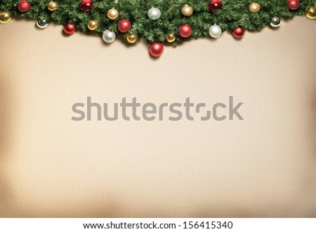 Christmas decoration with fur and baubles.