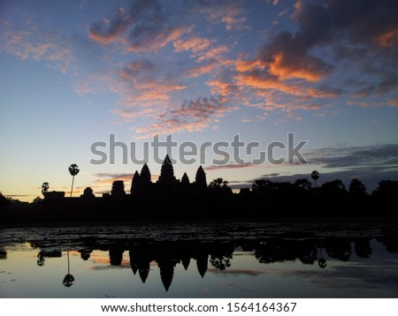 Morning glow glows in Angkor Wat Millennium Temple. The beautiful natural scenery that matches the moat is wonderful.  #1564164367