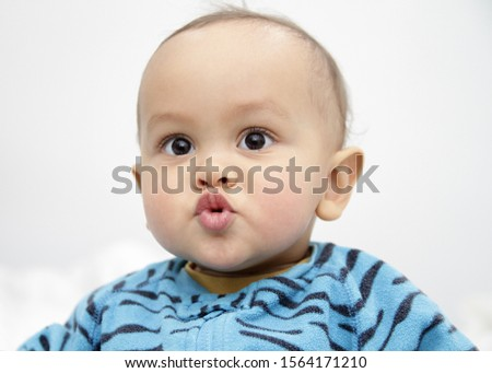 baby looking with big blue eyes just been cared for after having a good sleep in bed with mother stock photograph stock photo