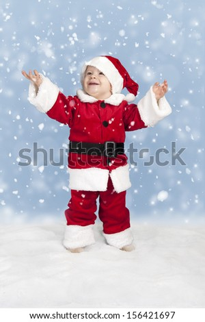 snowing on little child in santa clothes,  #156421697