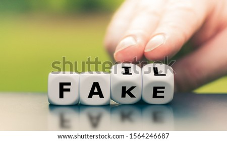 """Hand turns a dice and changes the word """"fake"""" to """"fail"""". #1564246687"""