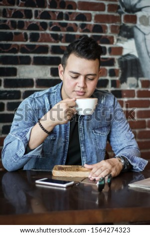 young man in a coffee shop #1564274323