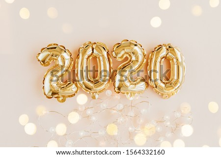Foil balloons in the form of numbers 2020. New year celebration. Gold and silver Air Balloons. Holiday party decoration.  #1564332160