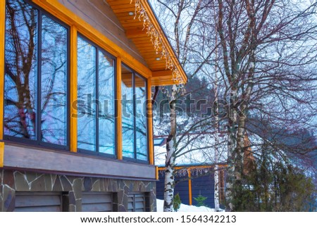 Country house with panoramic Windows. Construction of cottages. Rent cottages. Winter camping. Cottages on the background of a snow-capped mountain. #1564342213