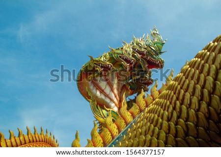 Serpent statue,Naga statue and blue sky, Sculpture of  7  head Naga statue,Serpent statue and blue sky background, Wat Tham Pha Daen,Sakon Nakhon,Thailand. #1564377157